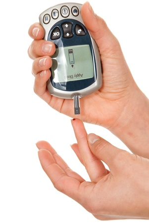 diabetes needles: Diabetes patient poked finger to measure a glucose blood level test by new smart glucometer isolated on a white background