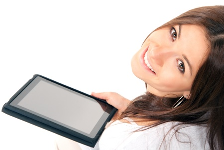 digitized: Pretty brunette woman holding in hand new electronic tablet touch pad computer pc digital screen and smiling, looking at the camera on a white background