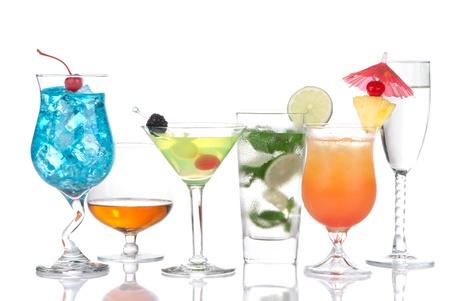 Cocktails variation. Blue Curacao hawaiian, mojito, on the beach, tequila sunrise, cognac, martini, tequila sunrise in cocktail glasses isolated on a white background