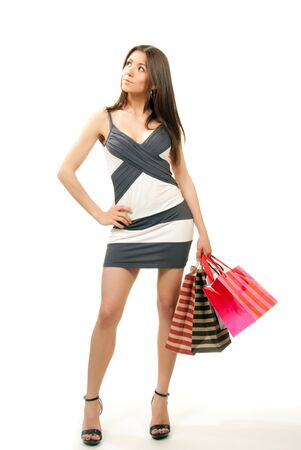 body bag: Full Body Happy Beautiful sexy woman with colorful gift shopping bags cheerful smiling in contemporary casual dress and top hills on a white background