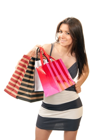 wench: Happy Beautiful sexy woman with colorful gift shopping bags cheerful smiling in contemporary casual dress and top hills on a white background Stock Photo