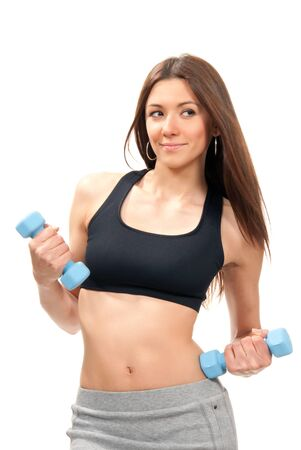 Fitness woman instructor on diet with perfect athletic body and abs working out with blue mini weights dumbbells in healthy life gym isolated on a white background