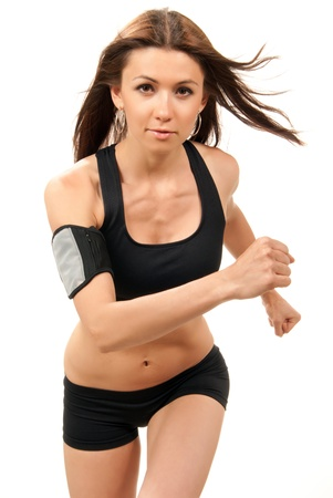 the runs: Slim fitness woman on diet  jogging, running in gym with muscular abs, arms, legs isolated on white background Stock Photo