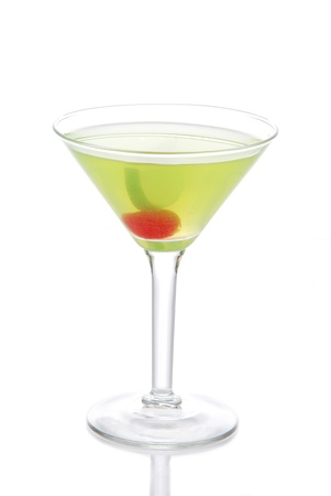 Green Cosmopolitan martini cocktail with vodka, rum,  liqueur, lemon juice, pineapple, maraschino cherry in small martinis cocktails glass isolated on a white background photo