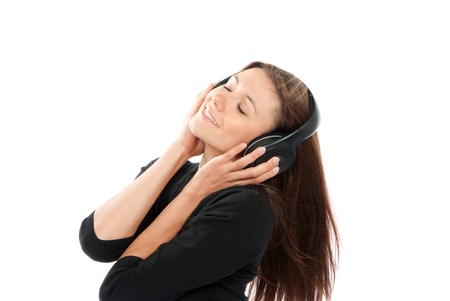 Brunette woman listen and enjoy the relax music in headphones, smiling, laughing and not looking in camera isolated on a white background photo