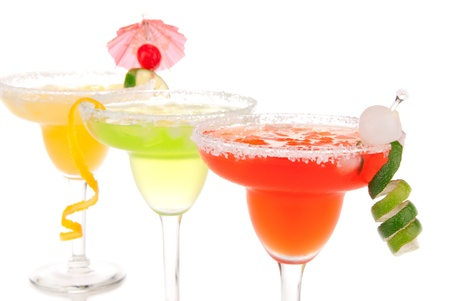 margarita glass: Strawberry, lime, apple Margaritas cocktails composition decorated with twisted lime, mint, cherry, cocktail umbrella in margarita glass isolated on a white background