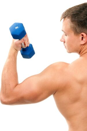 kg: Handsome man holding blue dumbbells in hand and working out, showing muscular arms, biceps isolated on a white background