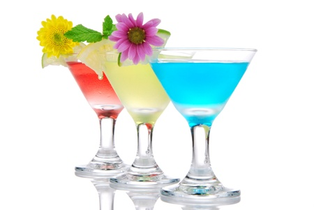 to woo: Tropical martini Cocktails row with vodka, light rum, gin, tequila, blue curacao, lime juice, lemonade, lemon slice and fresh summer flowers in martinis cocktail glass on a white background
