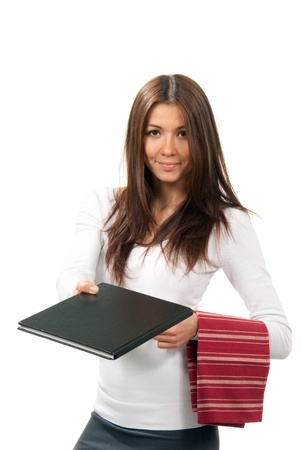 conclude: Attractive cheerful waitress giving a book menu and holding serviette hanging over the hand on a white background Stock Photo