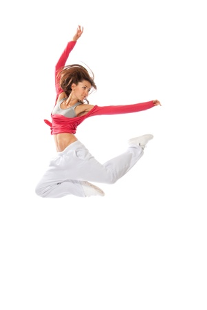New modern slim hip-hop style woman dancer jumping isolated on a white studio background  photo