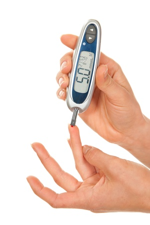 prick: Dependent first type Diabetes patient measuring glucose level blood test using ultra mini glucometer and small drop of blood from finger and test strips isolated on a white background