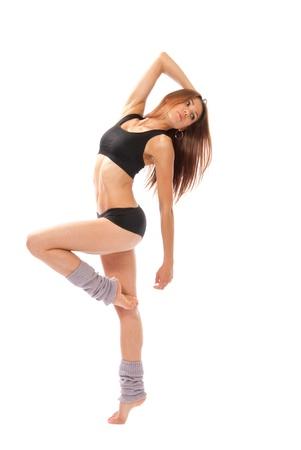 danza contemporanea: Pose de bailarina de ballet bastante delgado jazz moderno estilo contemporáneo mujer aislado en un fondo blanco studio