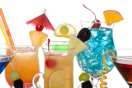 Popular alcoholic cocktails composition. Many cocktail drinks Blue hawaiian, mai tai, tropical  Martini, tequila sunrise, margarita, decorated orchids, cherry, lime, lemon, straw, umbrella isolated on a white background Stock Photo