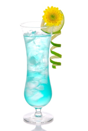 Blue hawaiian curacao cold cocktail decorated with pineapple, lemon twisted spiral and summer beautiful pink flower cocktails glass filled with ice isolated on a white background Imagens