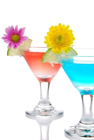 Cocktails martini row with vodka, light rum, gin, tequila, blue curacao, lime juice, lemonade, lemon slice and fresh summer flowers in martinis cocktail glass on a white background photo