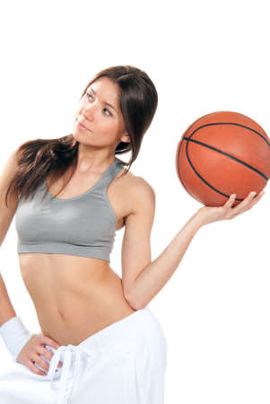 Basketball fitness brunette sexy young woman player holding basketball in hand wearing skirt and top isolated on a white background  photo