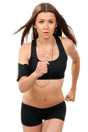 earphone: Happy young fitness beautiful slim brunette sport woman jogging and running, listening to music  isolated on a white background  Stock Photo