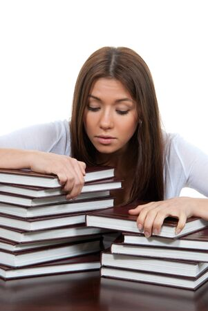 Bored High school or college girl reading student book getting ready for college classes on a white background photo
