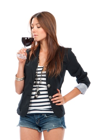 woman drinking wine: Woman Tasting sampling red wine isolated on a white background