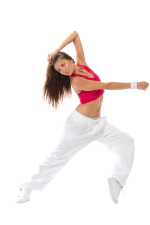 New pretty modern slim hip-hop style woman dancer dancing pose  isolated on a white studio background