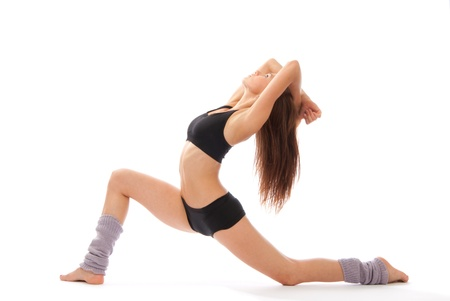 contemporary: Beautiful slim fitness woman stretching exercise on a white background Stock Photo