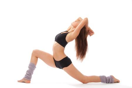 Schöne schlanke Fitness frau Dehnübung auf weißem Hintergrund Standard-Bild - 9837410