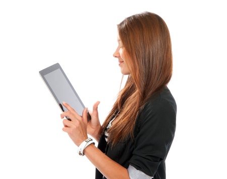 Brunette woman typing on her new electronic tablet touch pad one finger touches the digital screen isolated on a white background  photo