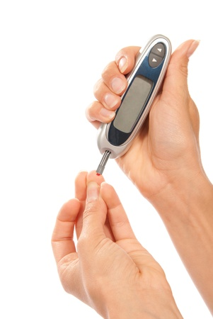 poking: Diabetes patient measuring glucose level blood test using ultra mini glucometer and small drop of blood from finger and test strips isolated on a white background