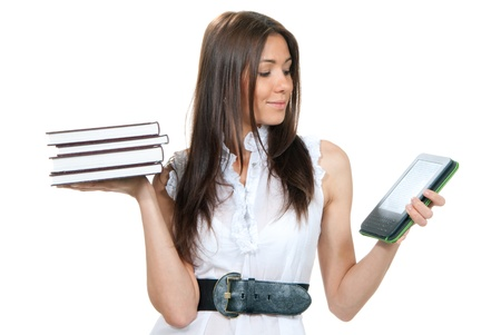 personal digital assistant: Woman compare books and new wireless reading digital book Device. She holds books and ebook reader in hands like balance isolated over white background