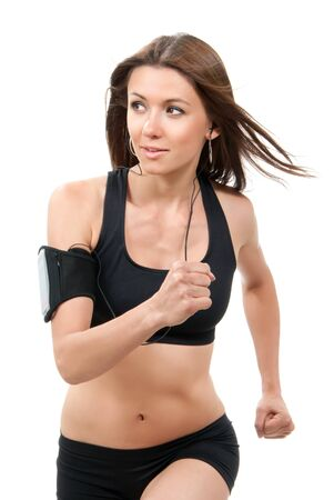 Happy young fitness beautiful slim brunette sport woman jogging and running, listening to music isolated on a white background  Stock Photo