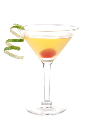 Yellow banana martini cocktail in martinis glass with lime twist and cherry isolated on a white background photo