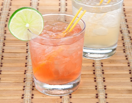 Alcohol long island Iced tea cocktails with lime photo