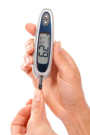 Dependent first type Diabetic patient measuring glucose level blood test using ultra mini glucometer and small drop of blood from finger and test strips isolated on a white background  photo