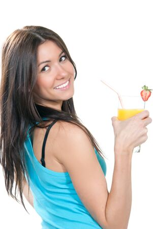 Young beautiful woman drinking orange juice cocktail with strawberry isolated on a white background  photo