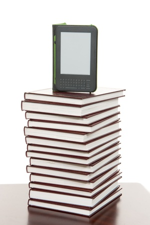 Reading digital ebook Device Display tablet Technology over stack of books  photo