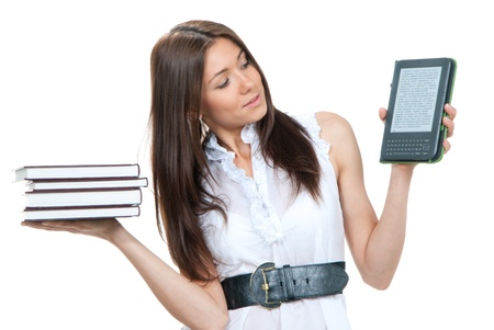Female compare books and new wireless reading digital book Device. She holds books and ebook reader in hands like balance isolated over white background  Stock Photo