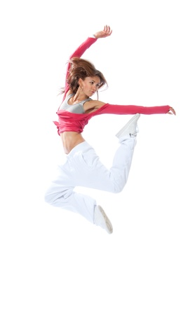 New pretty modern slim hip-hop style woman dancer jumping and dancing isolated on a white studio background  photo