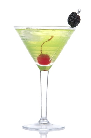 blue hawaiian drink: Green yellow alcohol cosmopolitan cocktail decorated with maraschino cherry and blackberry in martini cocktails glass isolated on a white background