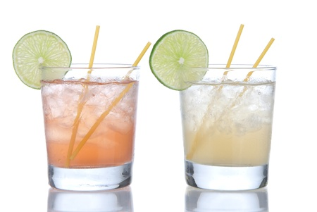 blue hawaiian drink: Cocktail margarita or long island Iced tea with lime in short cocktails glasses isolated on a white background
