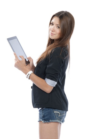 Brunette woman holding new electronic tablet touch pad computer pc and thinking about idea, one hand touches the digital screen isolated on a white background  Imagens