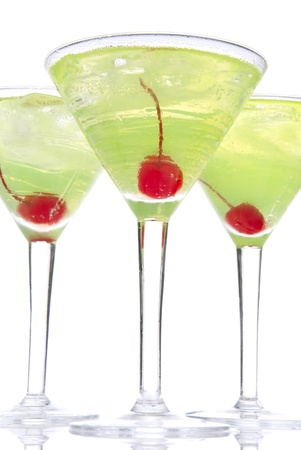 mocktail: Martini alcohol cocktails in row with cherry yellow and green over white background