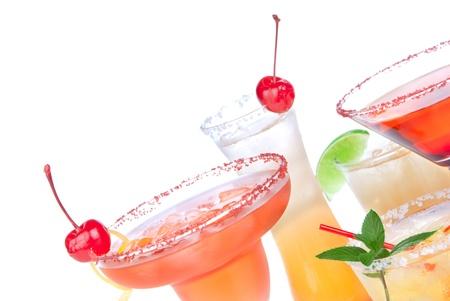 Margarita, martini cocktail, tequila sunrise, iced tea, tequila sunrise in cocktail glasses with mint, cherries, lemon spiral, lime, soda isolated on a white background