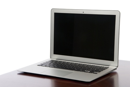 New Modern popular laptop thin computer, light weight with clipping path and black screen isolated on a white background photo