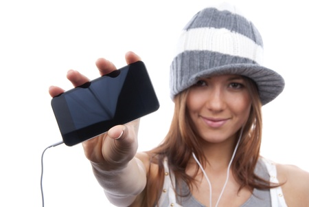 Young Pretty Woman Showing display of her new touch mobile cell phone and listen to music in earphonees. Focus on the hand and phone