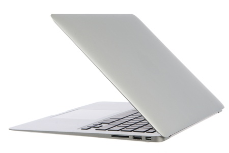 New high-speed thin silver aluminum laptop computer notebook side with touchpad, keyboard and open slots isolated on a white background