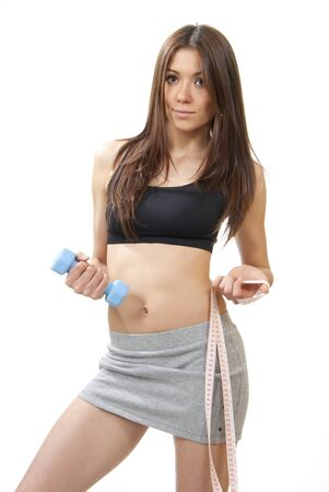 woman measuring: Beautiful slim fitness sports woman with dumpbell and tape measure weght loss diet concept isolated on a white background