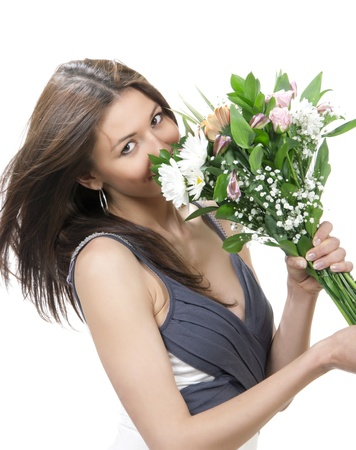 Beautiful woman with fresh bouquet of flowers roses on date  isolated on a white background photo