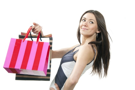 Pretty woman with colorful shopping bags in supermarket smiling isolated on white background Stock Photo - 10446568