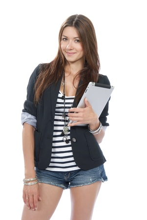 Pretty brunette woman holding in hand new electronic tablet touch pad computer pc digital screen and smiling, looking at the camera on a white background Stock Photo - 10746989