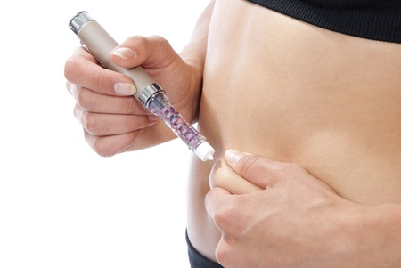 glycemic: Injections of insulin to blood sugar disease. Diabetic Glycemic control, single use small syringe with dose of lispro humalog used to treat type 1 insulin-dependent diabetes in adults